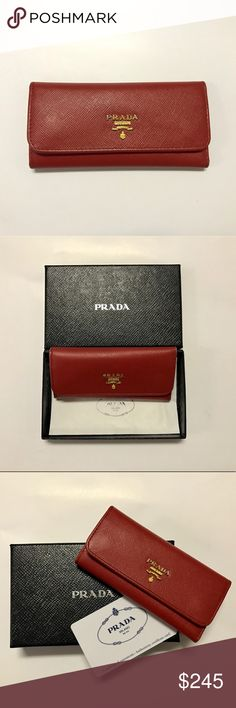 Prada Saffiano Keychain Key Pouch Red Prada red saffiano leather key case key holder with 6 key rings! In great condition with minor imperfections. 100% authentic -  comes with box and authenticity card. Prada Bags Wallets