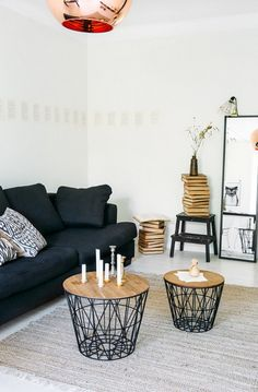 I like the big solid copper light balanced by the delicate wire coffee tables in this living room.