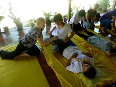 In February 2012 I got to help teach Thai women of the Andaman Coast (many of whom are survivors of the 2004 tsunami) a Thai Yoga Massage routine with my instructor, Sunny Klaber, as a part of her company, Integral Travel's Zia Project.  The Zia Project works to promote healing arts education, mentorships and small business loans in marginalized and displaced communities around the world.  (Photo taken in Kuraburi, Thailand, Feburary 2012)