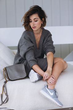 Wearing ASOS White knit dress, Deadly Ponies bag, By Charlotte necklaces and Nike trainers.