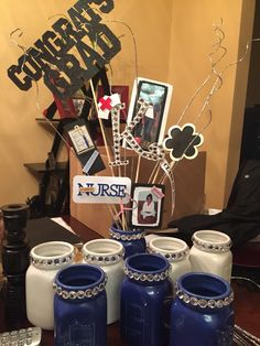 Centerpieces for my nursing themed grad party. I put baby, toddler, preteen photos, teenage and current photos.