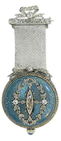 Paul Buhre Gold, Diamond and Enamel Lapel Watch by Paul Buhre, Retailed by Van Cleef & Arpels. Circa 1910.