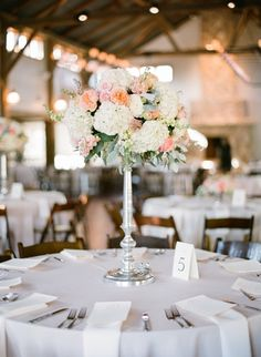 Gorgeous tall centerpiece. Photo by Taylor Lord Photography. www.wedsociety.com #wedding #centerpiece
