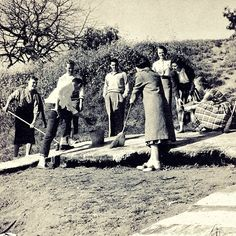 Members of the freshmen class painting the Big C green in 1955. Sophomores were traditionally responsible for maintaining the Big C and keeping it gold. Freshman classes would assert their presence on campus by painting the Big C a deep green.