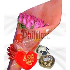 Send this two dozen cerise roses in a bouquet to your sister on her birthday with red heart shaped pillow, stuff dog and ferrero rocher heart. Make your feelings known loud and clear with a fresh bouquet of exquisite pink roses, an unforgettable gift of sophisticated beauty. Online Flower Shop, Ferrero Rocher, First Anniversary, Most Favorite, Perfect Match, Chocolates, Pink Roses, Heart Shapes, Bouquet