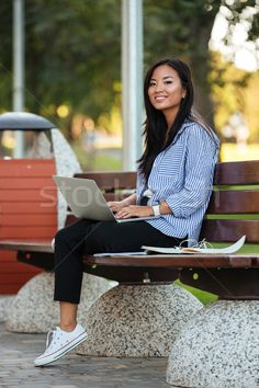 Portrait of a happy pretty asian female student stock photo (c) deandrobot (#8709498)   Stockfresh
