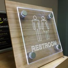 Custom illuminated LED restroom signs are available! Our satin silver standoffs create a beautiful effect on laser cut clear acrylic. Trotec Laser, Laser Cut Wood, Laser Cutting, Laser Cut Signs, Laser Cut Felt, Laser Cutter Ideas, Laser Cutter Projects, Laser Cut Acrylic, Clear Acrylic