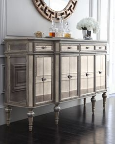 """Dresden Four-Door Mirrored Console Reflective console with multiple storage options. Made of hardwood with an antique-cream finish, silvery accents, and mirrored insets. Four drawers; four doors; four adjustable shelves (one behind each door). 64""""W x 19""""D x 39""""T. Imported. Boxed weight, approximately 241 lbs. More ▾ Dresden Four-Door Mirrored Console Compare At: $2,399.00 Special Value: $1,439.00"""