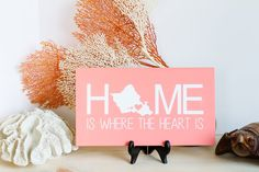 """Oahu Home Sign - Home Sign - Hawaii Sign - Oahu Sign - Hawaiian Sign - Hawaiian Home Sign - Home is where the heart is - Hawaii Sign - Oahu. Customize this sign with your personal state. Select from the drop-down box. Two Available sizes. CUSTOM State Sign - Home is where the heart is sign - Home sign - Home decor - Home State Sign - State Sign - Heart Sign - State Heart Sign Sizes: approximately 12"""" x 7"""" and 18"""" x 12"""", sizes may be off by +/- .5"""" Front: paint & sealed Back: sanded and…"""