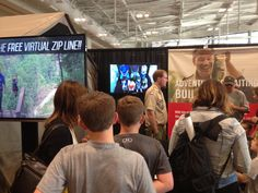 A short line of people wait to try the virtual zipline at the Boy Scouts of America booth.