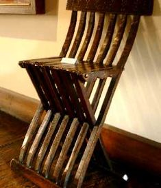 A 15th century folding chair from Switzerland and northern Italy.  Made from beech.