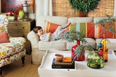 Make Arrangements Out of Greenery - 100 Fresh Christmas Decorating Ideas - Southernliving. Use simple sprigs of greenery in colorful glass vases or jars for a quick and easy arrangement on the coffee table. Tie ribbon or fabric scraps strung with brightly colored Christmas ornaments around the neck of the vase for added detail.