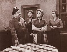 Classic kitchen scene from the 'Honeymooners' TV show of the 1950s. From left, Jackie Gleason, Art Carney, Audrey Meadows, and Joyce Randolph.
