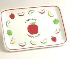 "Ceramic ""Shana Tova"" Apple Plate by R.L.. $26.99. Item Dimensions: 8.50"" l x 6.00"" w x 1.00"" h. A simple and fun apples and honey plate. Perfect for any home and will bring life to the Rosh Hashana table!"