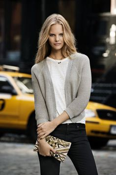 Marloes Horst [outfit: black skinnies, white basic top, and grey cardigan, with a statement clutch]