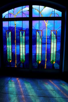 Lovely stained glass with cool, under water colors of blue, purple and green.