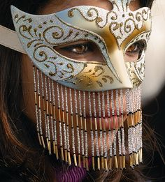 Venetian mask with beaded fringe. #masks #venetianmasks #masquerade http://www.pinterest.com/TheHitman14/art-venetian-masks-%2B/