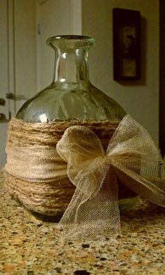 upcycle old wine or hard liquor bottles