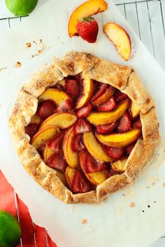 A simply easy dessert, this Strawberry Peach Galette is naturally sweet, with just a touch of honey and lime juice, and is ready to enjoy in under an hour!