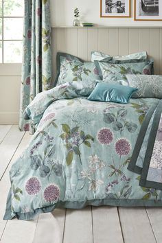 Buy Cotton Wild Hedgerow Teal Blackout Eyelet Curtains from the Next UK online shop
