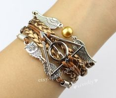 The ancient silver owl harry potter the snitch charm by vividiy, $5.99