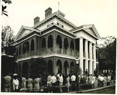 The Haunted Mansion was originally designed to be a walk through attraction. Some Imagineers attended the World's Fair where they saw the People Movers on display and knew that they had to be part of the Mansion. That's why we walk through the first part and ride through the rest. :0)