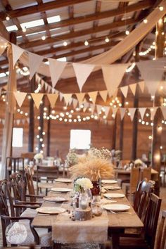 rustic barn wedding reception ideas with white lights and banners / http://www.deerpearlflowers.com/barn-wedding-reception-table-decoration/2/