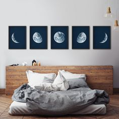 This a gorgeous print set of 5 moon phases, lovingly restored from a 100-year-old astronomy textbook. It has a midnight blue background, which Ive antiqued with a delicate patina. I just love how it instantly adds charm and a touch of drama to any room. This unframed set is printed on archival museum-quality paper. OPTIONS ❤ Buy this in a set of 4: http://etsy.me/2jP9oYx SEE MORE ❤ Astronomy & navigation: http://etsy.me/2isMmTm ❤ Fish & sea animals: htt...