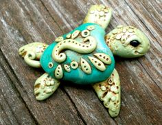 Clay Sea Turtle...adorable little guy!  Resembles or looks inspired by Polymer Clay artist christi friesen.  I love Christi Friesen's work she's very very creative.