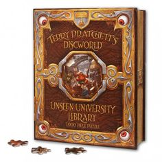 Official Discworld Jigsaw puzzle featuring Unseen University's Great Library, illustrated by David Wyatt, cover artist for numerous Terry Pratchett books - Ook!