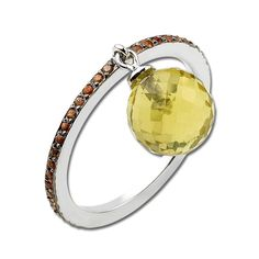 A simple delicate 18K white gold ring with a row of 0.235 carat orange sapphires and a gorgeous a lemon amethyst. Wear alone or stacked with similar delicate rings to put your own personal spin. #fashion #style #jewelry
