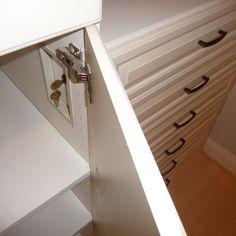 Hideaway locks to keep adjacent jewelry drawers safe.  Premier Garage.
