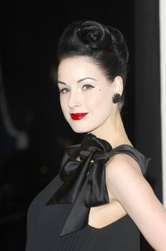 black hair, porcelain skin and red lips!