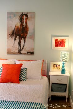 Budget friendly ideas for Bedroom paint colour ideas for young girl or tween using light blue green, teal, coral and benjamin moore icy moon drops with cil duo paint (which was awesome).  Artwork organization and homemade bulletin board too for kids rooms #KidsDecor #GirlsDecor