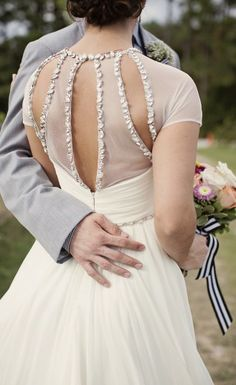 Sheer, modified keyhold back with sequin edging. Beautiful wedding gown. | Amy Boston Photography