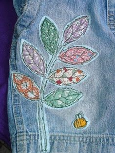 Applique leaves..I've done something like this to patch jeans that fit too perfectly to discard.