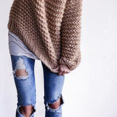 A cozy knit sweater layered over a tee and boyfriend jeans. Love this casual look.