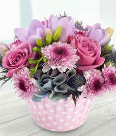 Berry Burst Cupcake An adorable pink and mauve cupcake container arrangement. Orchid Flower Arrangements, Beautiful Flower Arrangements, Floral Bouquets, Floral Cupcakes, Cupcake Flower, Raindrops And Roses, Hand Flowers, Beautiful Rose Flowers, Deco Floral