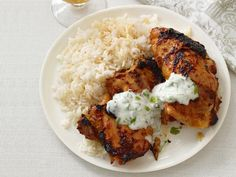Chicken Tandoori Recipe -- a delicious way to dress up chicken for a summer BBQ, and the tangy cilantro yogurt sauce is the perfect compliment. Best Chicken Thigh Recipe, Chicken Thigh Recipes, Recipe Chicken, Food Network Recipes, Food Processor Recipes, Cooking Recipes, The Chew Recipes, Cooking Food, Grilling Recipes