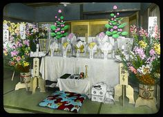 A funeral coffin placed in a drawing room  Enami Studio Lantern Slide No : 474.  About 1920's, Japan