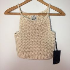 UNIF Crochet Top UNIF brand cream colored thick quality crochet crop top. Featuring braided straps and thick 100% cotton material. Really heavy and great quality top that's sure to match most anything in your wardrobe.   ✧ women's size medium - fitted style top that could fit a size small as well ✧ new with tags ✧ NO TRADES, sorry ladies! UNIF Tops Crop Tops