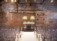 Just because your big day is taking place somewhere urban, like this Atlanta wedding at a historic warehouse, doesn't mean your seating can't be glam. Louis Ghost Chairs make a dramatic statement contrasted with the brick-filled environment.  Photo by Melissa Schollaert Photography
