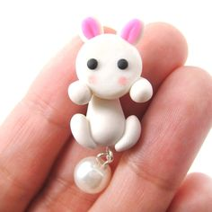 - Details - Sizing - Shipping This is for ONE handmade bunny rabbit shaped stud earring in white with pearl detail! It is made up of two parts, one that goes in front of your ear lobe and the other th