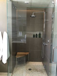 modern bathroom design for teenage boy.  Steam shower with dornbracht fixtures and cove light, pebble stone tile.  Arcturus Studio Interior Design.