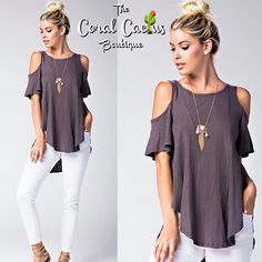 The Amanda open shoulder top has a loose, flowy fit, hangs lower in back, beautiful charcoal color looks great with white denim! Runs large! Free shipping over $50