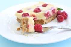 Lemon Raspberry Bars on twopeasandtheirpod.com These tart lemon bars are creamy and dotted with raspberries! A favorite at our house!