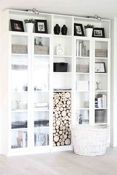 LOVE the idea of using a bookcase to store wood!