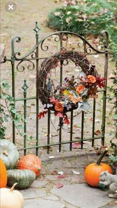 Perk up a lovely gated entryway with plump pumpkins and a grapevine wreath bedecked in fall foliage and bright orange roses. Autumn Garden, Autumn Home, Fall Containers, Cottage Style Decor, Southern Ladies, Growing Grapes, Fall Dinner, Garden Structures, Flower Farm