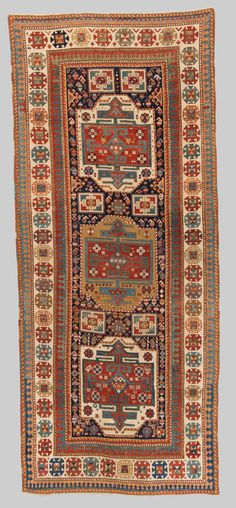 Grogan and Company | CAUCASIAN RUG, late 19th century; 8 ft. 1 in. x 3 ft. 5 in.