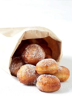 "Meyer Lemon & Sour Cream Donuts from Helene Dujardin of Tartlette: ""These donuts are so easy to make it's a crime, well, not to make them. Seriously. Wet ingredients, dry ingredients, stir, rest and fry. Tada! These are a real treat as we don't usually eat fried anything but if there is one thing I will not compromise about, it's properly fried lemon and sour cream donuts!"""